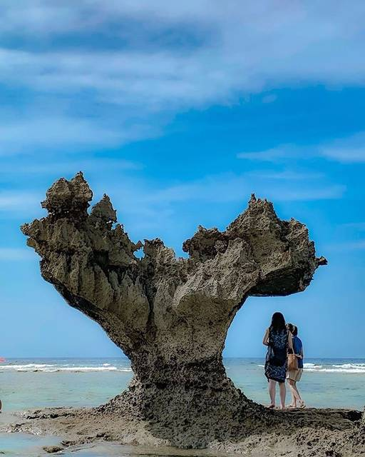 """[Official] VISIT OKINAWA JAPAN on Instagram: """"The erosion from the battering waves created Kouri Island's adorable heart rock. It's one of the most famous heart-shaped formations in…"""" (774260)"""