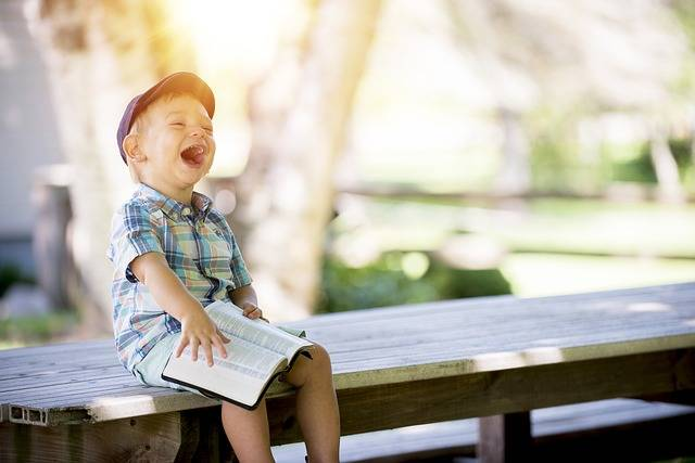 Boy Laughing Reading - Free photo on Pixabay (231351)